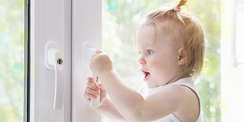 baby looking at window