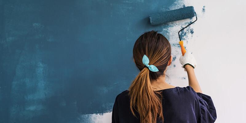 Girl painting walls